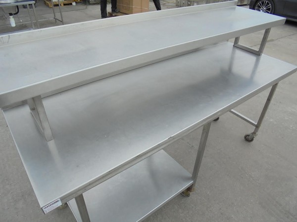 Stainless steel table with gantry shelf