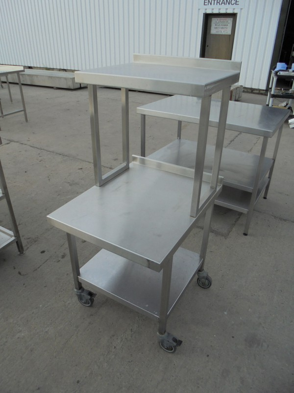Used steel table with gantry shelf