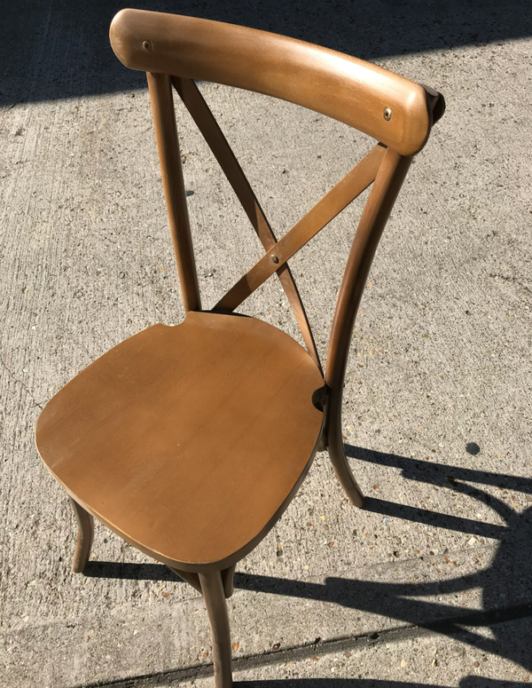 Used golden cross-back chairs