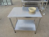 steel table with waste hole