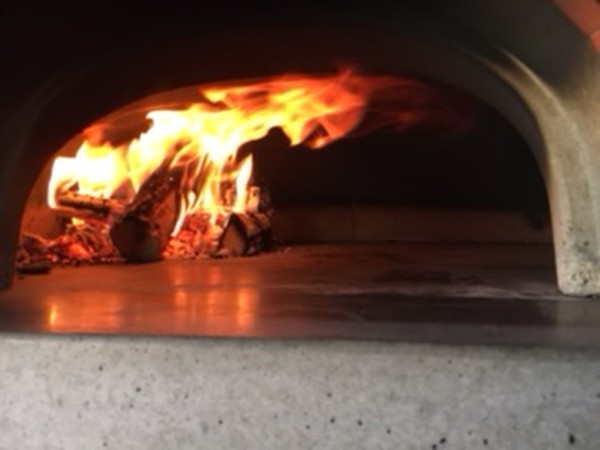 bespoke wood fired pizza oven in pizza trailer
