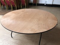 Round wooden banqueting tables
