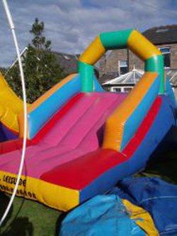 colourful used bouncy inflatable slide