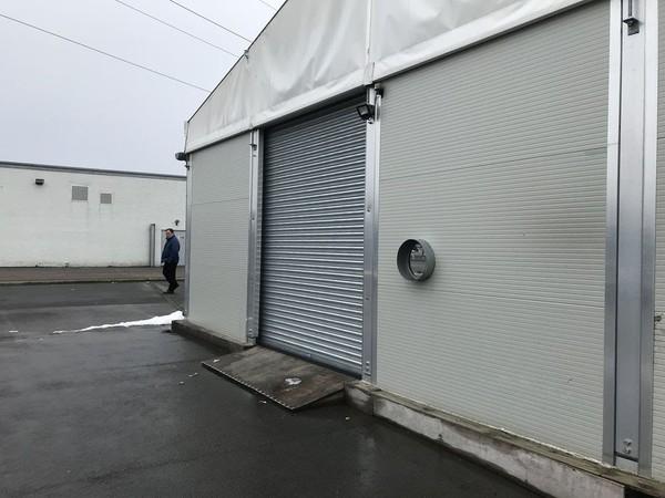 Roller shutter door for a framed marquee