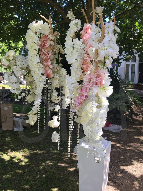Wedding decor flowers on artificial trees
