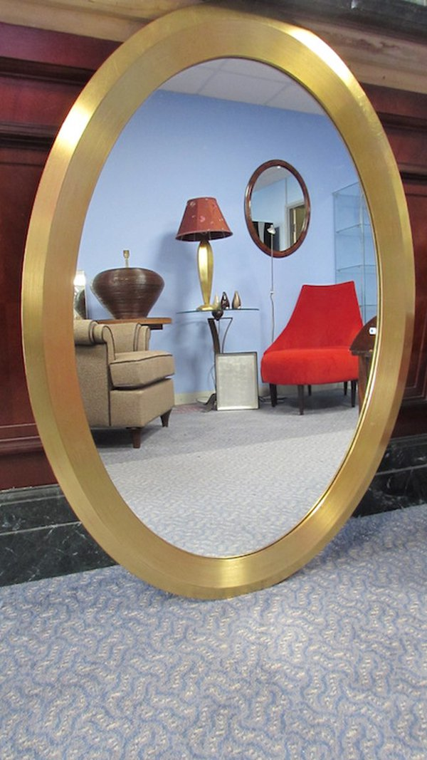 Gilded oval mirrors