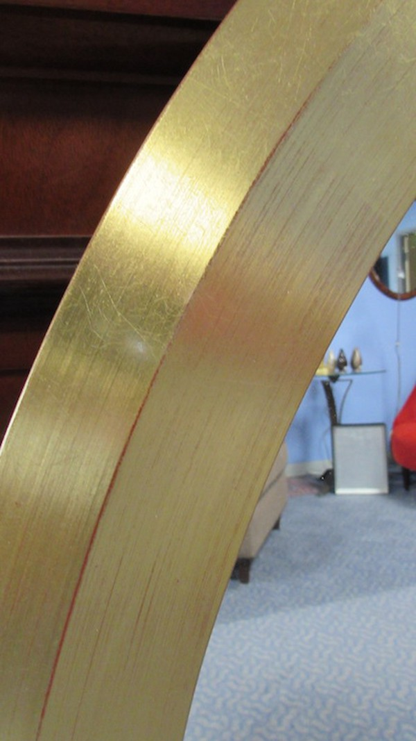 Gilt / Gold oval mirrors