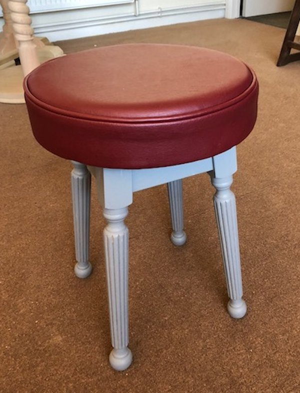 reeded leg low stools with burgundy faux leather stool tops