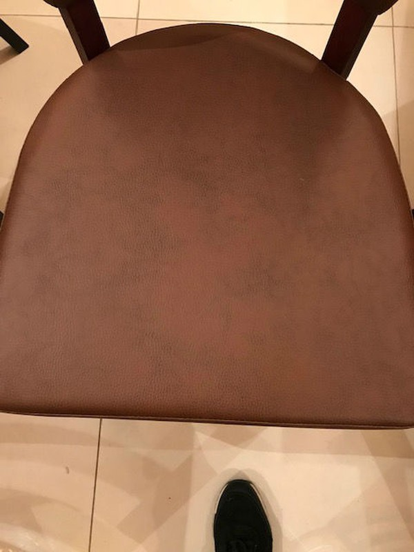 Brown leather faux leather chairs