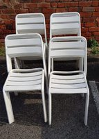 White Metal Stacking Chairs
