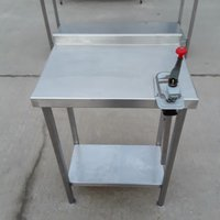 Stainless steel table with can opener