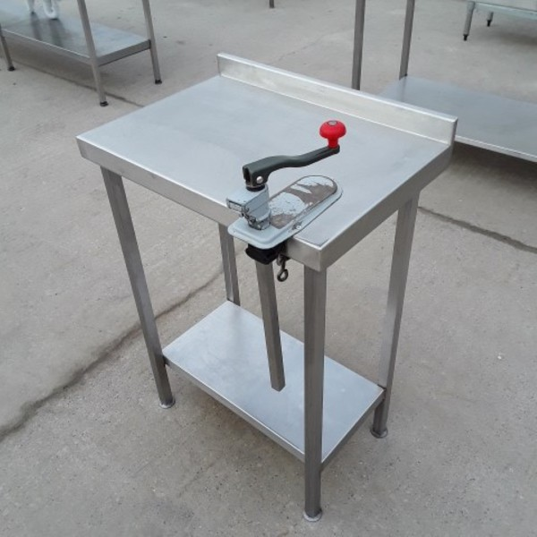 Commercial can opener on a table
