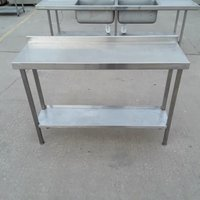 Used   Stainless Steel Table.  Shelf - Adjustable feet - Upstand  130cmW
