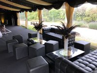 Black leather sofa for parties