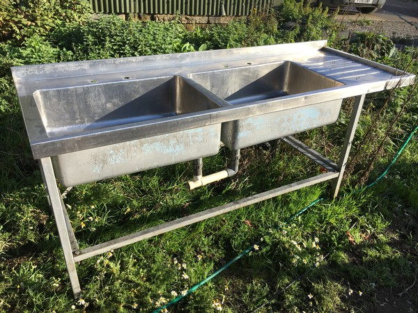 Double bowl catering sink with waste fitting