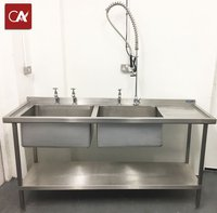 Double bowl catering sink with spray attachment