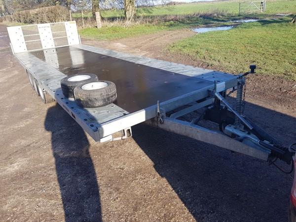 Tilt bed transport trailer