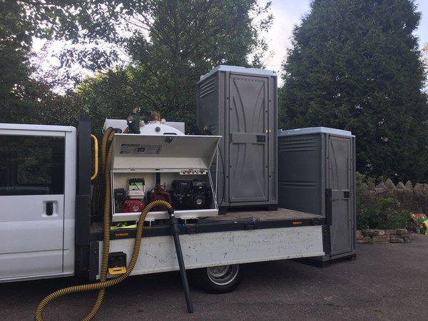 Toilet service vacuum tank