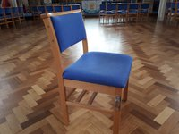 Linking church chairs with book shelf