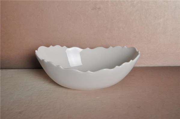 Porcelain scallop edged serving bowl
