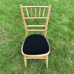 Ex hire chiavari chairs with black seat pads