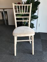 Limewash Chivari Banqueting Chairs with Cream Seat Pads