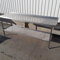 Stainless steel 1.5m table with upstand back and right hand