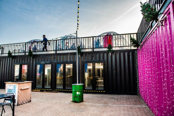 Shipping container cafe with roof terrace