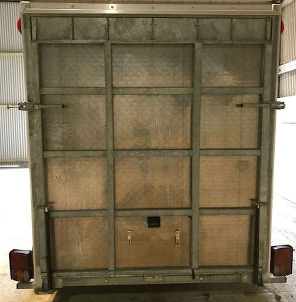 Trailer ramp door