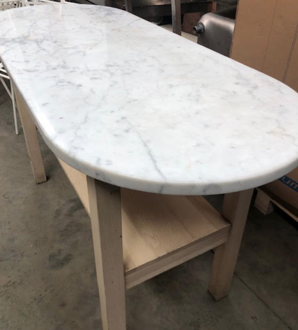 Secondhand oval poseur table