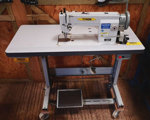 Sewing machine on table for sale