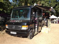 Black Mercedes Vario 614D food truck.