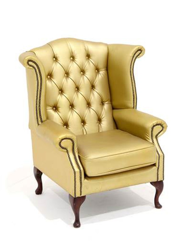 Gold wingback chairs with diamante buttons