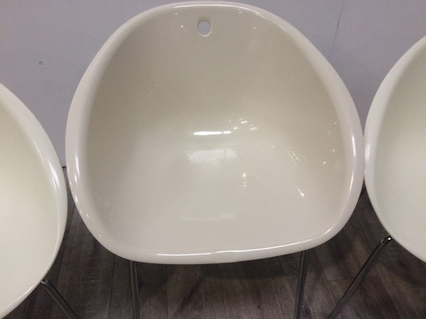 Ivory plastic tub chairs