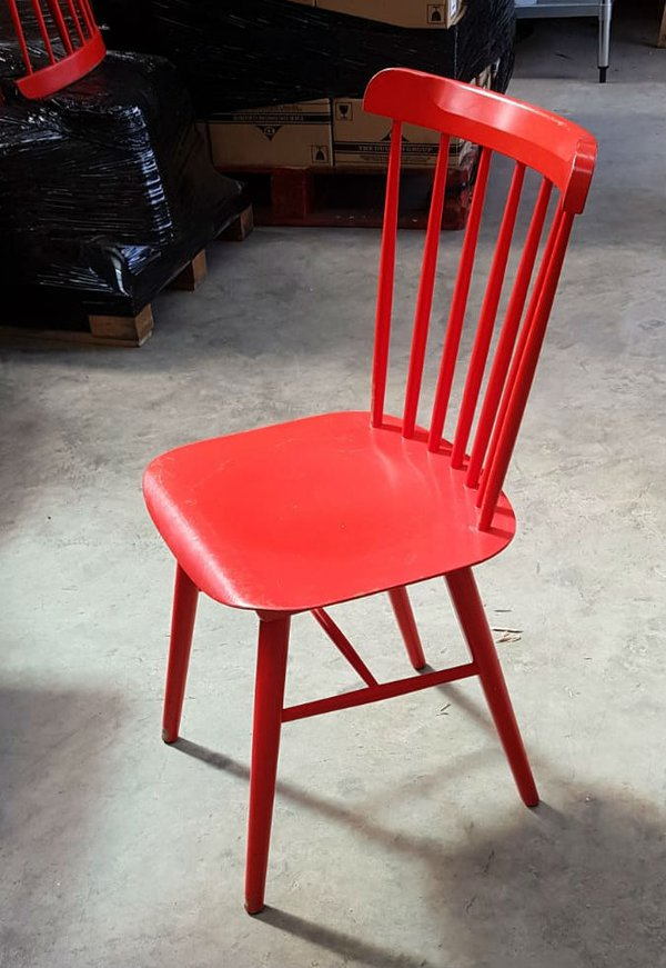 Red spindle backed cafe chairs