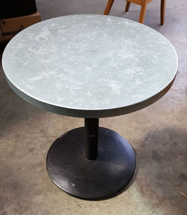 Round table with a zink top