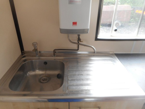 Sink with instant hot water heater