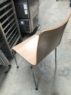 Bent plywood stacking chairs
