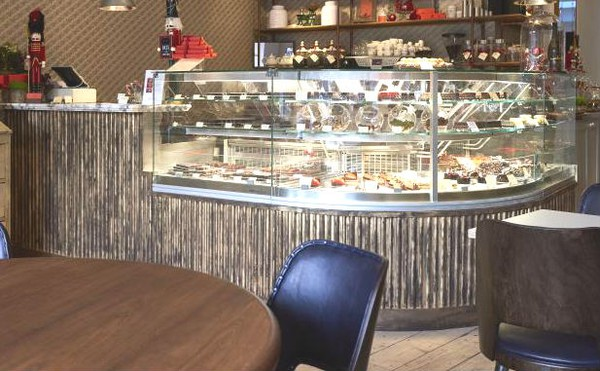 Curved Chocolate display serve over fridge
