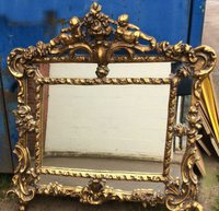 Mirror with cupids