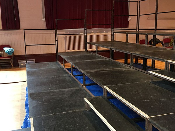Four level tiered seating system