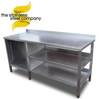 Stainless steel table with shelves and cupboards.
