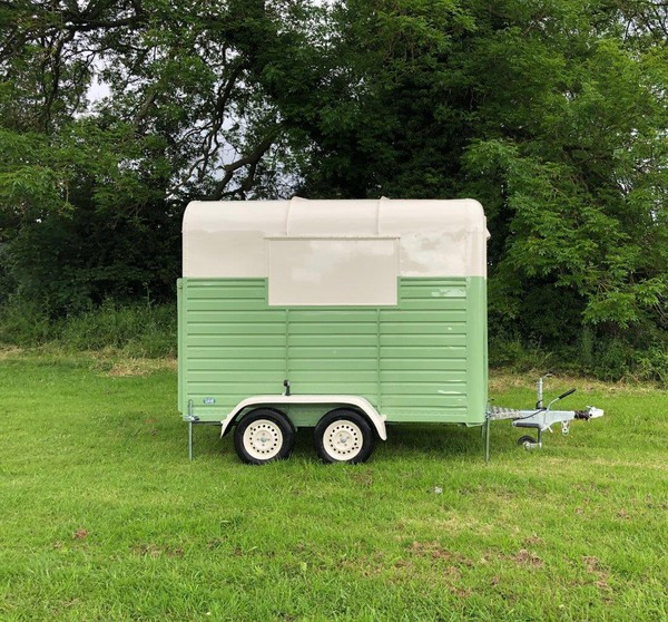 Green and cream vintage horse box trailer