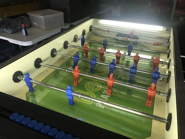 Football table with red and blue players
