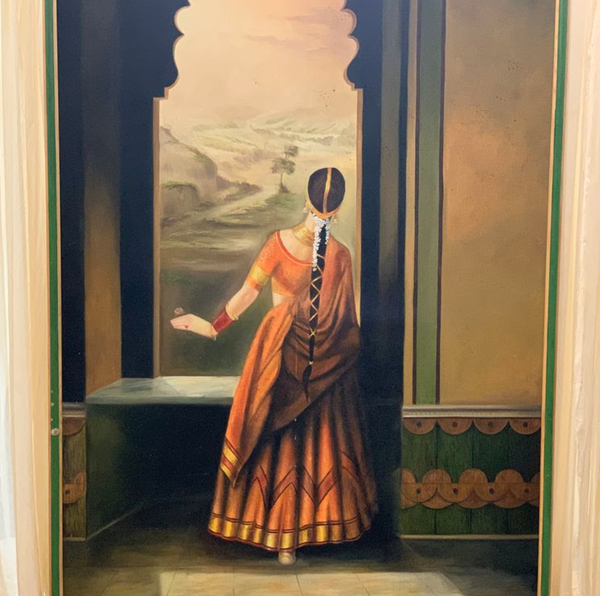 Indian lady at a window