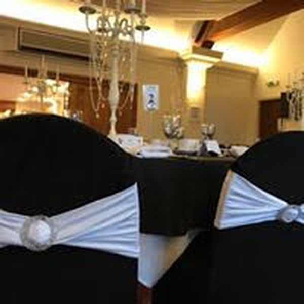 Black chair covers with white sash