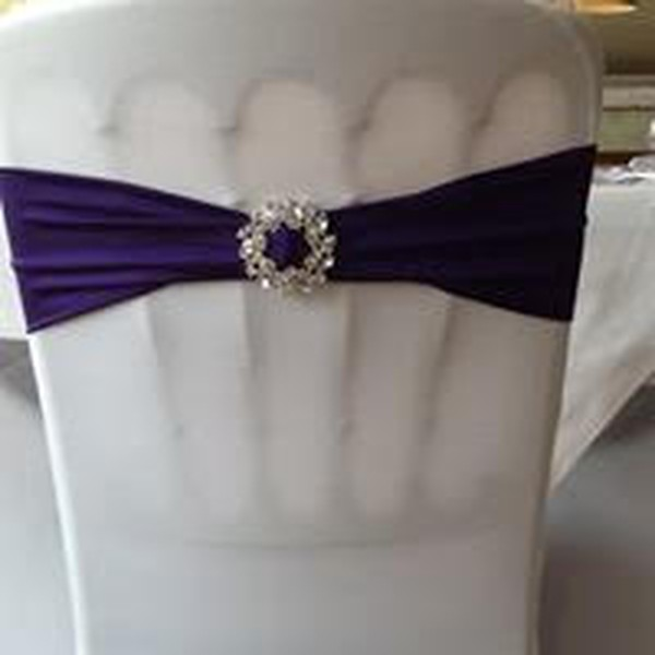 White chair covers with purple sash