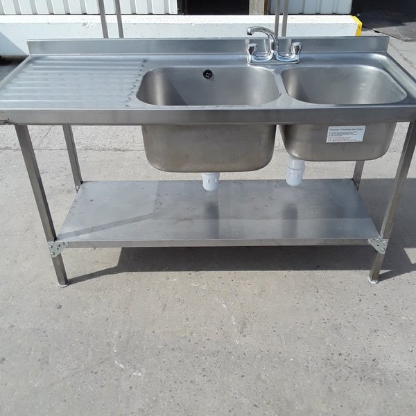 Double sink with left hand drainer