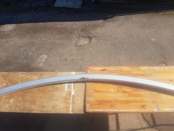 Curved aluminium roof beam