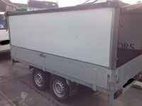 Drop side trailer with box
